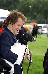 TOM PARKER BOWLES  at the 3rd annual Macmillan Dog Day in aid of Macmillan Cancer Relief held at Royal Hospital Chelsea, London SW3 on 5th July 2005.<br />