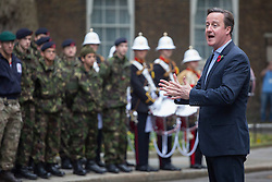 © licensed to London News Pictures. London, UK 09/11/2013. Prime Minister David Cameron addressing the Royal Marines and Commando 999 on Downing Street on Saturday, November 9, 2013 after Commando 999's attempt to break the Speed March World Record by completing the 26.2 mile London marathon course in less than 4 hours and 19 minutes. Photo credit: Tolga Akmen/LNP