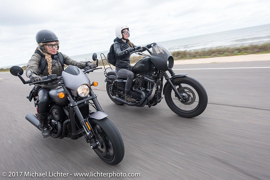 Iron Lilies Leticia Cline (L) on a new 2017 Harley-Davidson 750 Street Rod alongside Kristen Lassen on a 2014 Harley-Davidson Iron 883 Sportster as they ride AIA near Flagler Beach during Daytona Beach Bike Week. FL. USA. Tuesday, March 14, 2017. Photography ©2017 Michael Lichter.