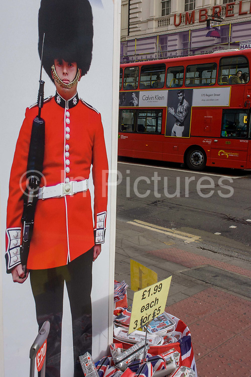 With a London bus in the background, a male model advertisises Calvin Klein underwear and a Coldstream guardsman appears on a poster outside a tourist shop in central London. It is a scene of masculinity and physique. Located on a street corner near the British Museum in central London, we see these iconic symbols for Britishness, for the tourism industry and for Britian's UK identity.