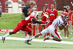 01 September 2012:  Nik Gillum stretches out for a reception with Mike Banks on his flank during an NCAA football game between the Dayton Flyers and the Illinois State Redbirds at Hancock Stadium in Normal IL