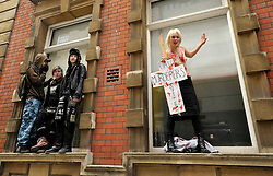 © Licensed to London News Pictures. 02/04/2012.  Performance artist and human rights activist Milly Fish (right) takes part in a protest against unmanned aerial vehicles or drones used for military operations in Afghanistan and elsewhere and for surveillance in the UK.  The protest was outside a conference on UAVs at Armada House in Telephone Avenue in central Bristol.  Police made several arrests...Photo credit : Simon Chapman/LNP