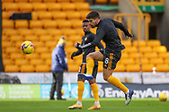 Ruben Neves (8) of Wolverhampton Wandererswarms up during the Premier League match between Wolverhampton Wanderers and West Bromwich Albion at Molineux, Wolverhampton, England on 16 January 2021.
