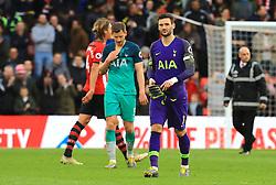 Tottenham Hotspur's Jan Vertonghen (centre) and goalkeeper Hugo Lloris appears dejected after the final whistle