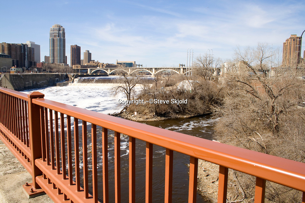 St Anthony Falls and Mississippi River viewed from the Stone Arch Bridge.  Minneapolis Minnesota USA