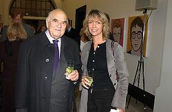 LORD WEIDENFELD and SABRINA GUINNESS at a party to celebrate the publication of 'You Are Here' by Rory Bremner, Juhn Bird and John Fortune held at the National Portrait Gallery, St.Martin's Place, London on 1st November 2004.<br />