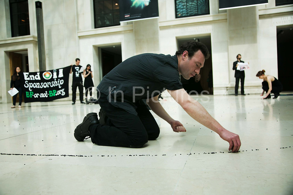"""The art activist protest group Bp-or-not-Bp make an artistic intervention at the British Museum to highlight the fact that the oil company BP sponsors a show called Sunken Cities at the Museum May 17 2016. (photo by Kristian Buus/In Pictures via Getty Images) <br /> The press release states:  """"The lines of stones in the artwork represent the 340 people forcibly disappeared in the four months prior to BP signing a $12bn dollar deal with the Sisi regime – a rehash of a deal it had made with the Mubarak regime. The total number disappeared under the Sisi regime may run into thousands. Teargas is a weapon that was used both to repress popular protest in Tahrir Square during the revolution but also those who actively opposed BP's operations in the country. """""""