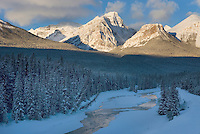 The Bow River and Peaks of the Bow Range during a winter sunrise, Banff National Park Alberta Canada