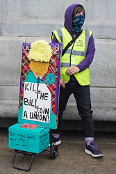 A woman holds a sign bearing an image of Prime Minister Boris Johnson and urging people to join a trade union at a Kill The Bill demonstration in Trafalgar Square as part of a National Day of Action to mark International Workers Day on 1st May 2021 in London, United Kingdom. Nationwide protests have been organised against the Police, Crime, Sentencing and Courts Bill 2021, which would grant the police a range of new discretionary powers to shut down protests.