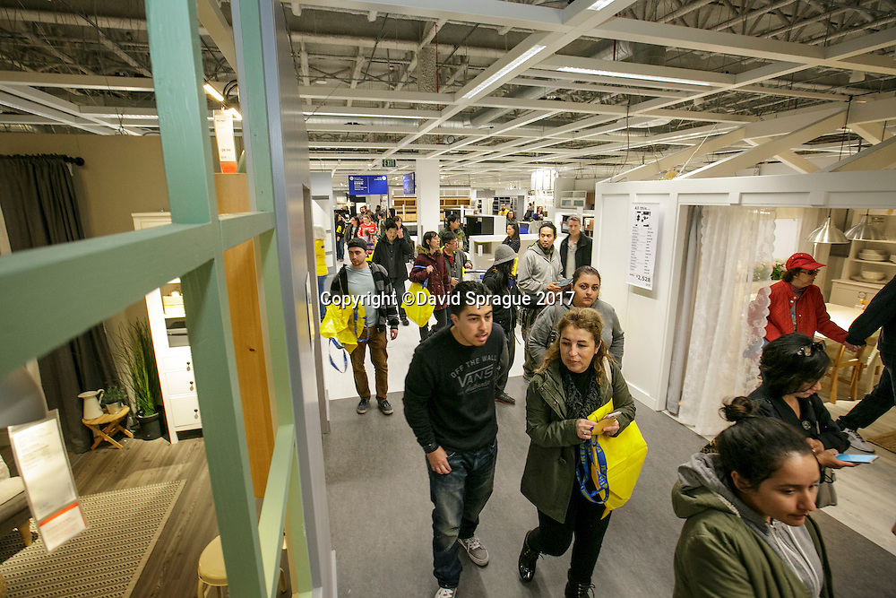 Customers stream through at the grand opening of the new Ikea in Burbank. The new Ikea store comes in at 456,000 sf, compared to the old one at 242,000 sf. And 1,700 parking places.  Feb. 8, 2017  Photo by David Sprague