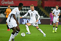 Football - 2019 / 2020 EFL Carabao (League) Cup - Second Round: Swansea City vs. Cambridge United<br /> <br /> Reggie Lambe of Cambridge United  on the ball, at Liberty Stadium.<br /> <br /> COLORSPORT/WINSTON BYNORTH