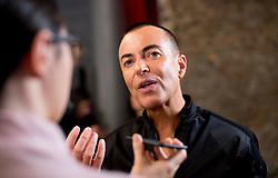 Designer Julien Macdonald is interviewed on the backstage during the London Fashion Week SS18 show held at No 1 Invicta Plaza, London