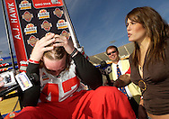 MORNING JOURNAL/DAVID RICHARD.Ohio State linebacker A.J. Hawk, left, runs his hands through his hair while he is interviewed by his girlfriend Laura Quinn Friday in Tempe, AZ. Quinn is the sister of Notre Dame quarterback Brady Quinn and she was working for ESPN while interviewing the oppossing players.