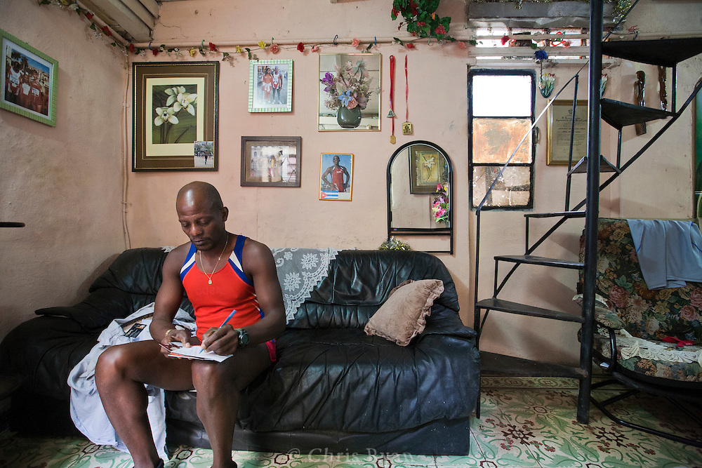 Runner in his home, Havana Vieja, Cuba