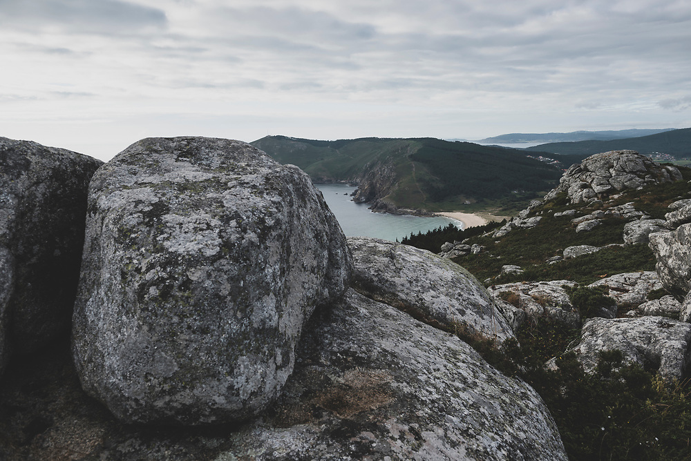 The rugged Atlantic coastline, including a sandy beach called Playa Mar de Fora, in Finisterre, Spain. Finisterre is the final destination for many pilgrims on the Camino de Santiago. (July 21, 2018)<br /> <br /> DAY 55: STAYED IN FINISTERRE