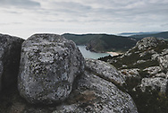 The rugged Atlantic coastline, including a sandy beach called Playa Mar de Fora, in Finisterre, Spain. Finisterre is the final destination for many pilgrims on the Camino de Santiago. (July 21, 2018)<br />