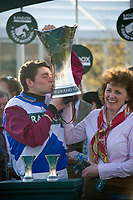 National Hunt Horse Racing - 2017 Randox Grand National Festival - Saturday, Day Three [Grand National Day]<br /> <br /> Derek Fox on kisses the trophy , accompanied by trainer Lucinda Russell after  One For Arthur wins  the 5.15, the Randox Health Grand National  at Aintree Racecourse.<br /> <br /> COLORSPORT/WINSTON BYNORTH<br /> <br /> <br /> <br /> <br /> <br /> <br /> <br /> <br /> <br /> <br /> National Hunt Horse Racing - 2017 Randox Grand National Festival - Saturday, Day Three [Grand National Day]<br /> <br />  in the 1st race the 1.45 Gaskells Handicap Hurdle at Aintree Racecourse.<br /> <br /> COLORSPORT/WINSTON BYNORTH