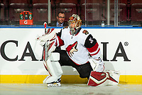 KELOWNA, BC - SEPTEMBER 29:  Antti Raanta #32 of the Arizona Coyotes stretches on the ice during warm up against the Vancouver Canucks at Prospera Place on September 29, 2018 in Kelowna, Canada. (Photo by Marissa Baecker/NHLI via Getty Images)  *** Local Caption *** Antti Raanta;