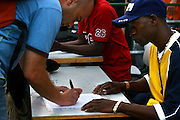 "An activist for the African workers in Israel union, sign people on a petition in attempt to prevent banishment of african refugees children and children of migrant workers.  Saturday, May 12, 2007. A black music festival ""Groove Refugee"" took place in Tel Aviv, all income will serve the struggle to prevent those children deported from Israel."