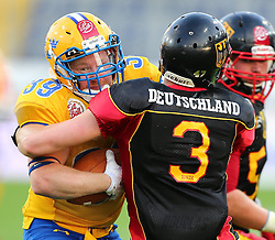 03.06.2014, NV Arena, St. Poelten, AUT, American Football Europameisterschaft 2014, Gruppe A, Schweden (SWE) vs Deutschland (GER), im Bild Christian Forsman, (Team Sweden, RB, #39) und Sebastian Schoenbroich, (Team Germany, DB, #3) // during the American Football European Championship 2014 group A game between Sweden vs Germany at the NV Arena, St. Poelten, Austria on 2014/06/03. EXPA Pictures © 2014, PhotoCredit: EXPA/ Thomas Haumer