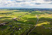 Nederland, Noord-Holland, Gemeente Purmerend, 14-06-2012; polder Wijdewormer, droogmakerij uit de 17e eeuw. Het oorspronkelijke landschap is aangetast door de aanleg van autosnelweg A7. Recht boven het midden de bebouwing van Purmerend. Onde in beeld golfterrein van de buurtschap 't Kalf..Wijdewormer polder, reclaimed land dating from the 17th century. The original landscape has been affected by the construction of motorway A7..luchtfoto (toeslag), aerial photo (additional fee required);.copyright foto/photo Siebe Swart