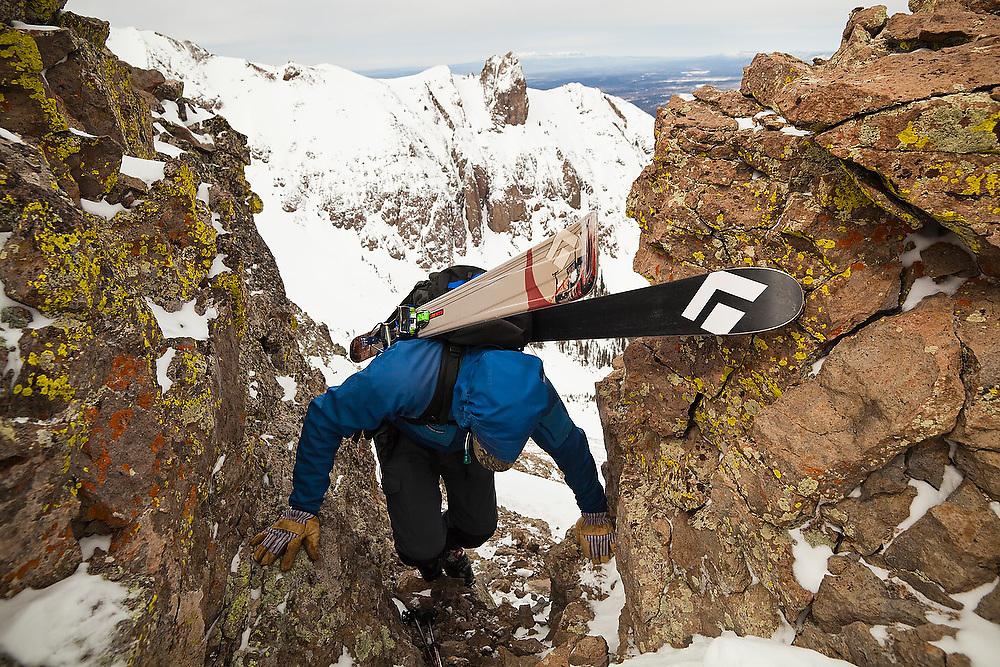 Backcountry skier Sterling Roop gains the summit ridge of Hayden Peak, San Juan Mountains, Colorado.