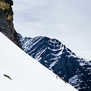 Andy Mahre skiing a ridgeline in Glacier National Park.
