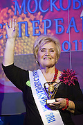 Moscow, Russia, 02/11/2011..73 year old Ludmilla Trafinovna waves ti the crowd after being declared overall winner at the first Moscow Super-Babushka contest, organised by the Moscow City Government Social Welfare Department. A total of 105 women aged over 50 entered to compete for various titles, including most stylish, modern, elegant, business-minded, creative, artistic, and cheerful granny.