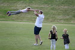 Mike Tindall entertains his daughter Mia and the children of his brother in law Peter Phillips at the Gloucestershire festival of polo at Beaufort.<br /><br />11 June 2017.<br /><br />Please byline: Vantagenews.com<br /><br />UK clients should be aware children's faces may need pixelating.