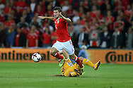 Ben Davies of Wales is fouled by Radu Ginsari of Moldova. Wales v Moldova , FIFA World Cup qualifier at the Cardiff city Stadium in Cardiff on Monday 5th Sept 2016. pic by Andrew Orchard, Andrew Orchard sports photography