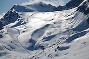Ski tracks from a snowcat skiing operation cover a mountain on Thompson Pass, near Valdez, Alaska.