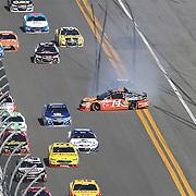 Ty Dillon (14) spins his car on the front stretch during the 58th Annual NASCAR Daytona 500 auto race at Daytona International Speedway on Sunday, February 21, 2016 in Daytona Beach, Florida.  (Alex Menendez via AP)