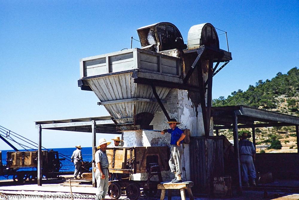Salt industry production workers, Salinera de Sa Canal, Ibiza, Balearic Islands, Spain in 1950s