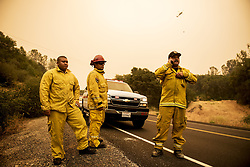 July 18, 2017 - Mariposa County, California, U.S. - California Department of Forestry and Fire Protection firefighter JACK CHANTHALA, left, Capt. GORGE SEGURA, center, and Capt. JERRY FERNANDEZ, right, prepare to deliver medicine to a Mariposa resident as crews continue to battle the Detwiler fire along Highway 49 in Mariposa County. (Credit Image: © Andrew Kuhn/The Merced Sun Star via ZUMA)