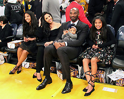 December 18, 2017 - Los Angeles, California, U.S - The retirement of the Los Angeles Lakers player, Kobe  Bryant's #8 and #24 jerseys was held Monday December 18,  2017 in Los Angeles, California during half time of the game  between with the Golden State Warriors. Kobe Bryant with  his family (L-R) Gianna Maria-Onore, wife, Vanessa Laine  Bryant, Kobe Bryant holding Bianka Bella and Natalia  Diamante. JAVIER ROJAS/PI (Credit Image: © Prensa Internacional via ZUMA Wire)