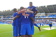 Cardiff City's Nathaniel Mendez-Laing (back) jumps on the celebrating players after Sol Bamba of Cardiff city (14) scores his teams 1st goal for a late equaliser . EFL Skybet championship match, Cardiff city v Sheffield Wednesday at the Cardiff City Stadium in Cardiff, South Wales on Saturday 16th September 2017.<br /> pic by Carl Robertson, Andrew Orchard sports photography.