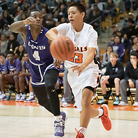 Tyrell Begay (23) looks to send a pass into the post as Dewayne Dawson (4) of Clovis tries to defend him at the Gallup Invitational held at Gallup High School. Clovis won 64-53.