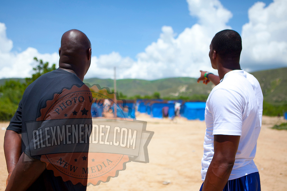 Adonal Foyle (L) and Dwight Howard (R) stop to explore a tent city while in Haiti to promote the Dwight Howard Fund.  Mandatory Credit: Alex Menendez Dwight Howard in Haiti after the 2010 earthquake for the D12 Foundation relief fund.