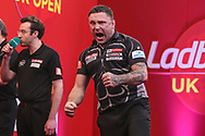 Gerwyn Price hits a double and celebrates during the Ladbrokes UK Open Darts 2021 at stadium:mk, Milton Keynes, England. UK on 7 March 2021.