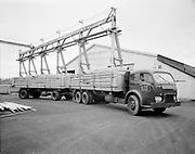 "Ackroyd 04792-1. ""Arcady Press. Oregon Washington Transport truck & trailer at Westwood homes. November 13, 1953"" (White truck, dual trailers 8x10"" neg)"