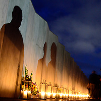 """Lights from camera cast shadows on the """"Wall of Names"""" at the Flight 93 National Memorial on the eve of the 14th anniversary of the terrorist attack on America near Shanksville, Pennsylvania on September 10, 2015.  UPI/Archie Carpenter"""