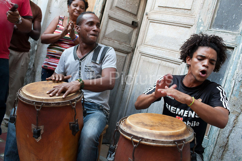 Music is an importatn part of Santeria, which is a syncretic religion practiced in Cuba, it is a mixture of Yoruba tribal practices brought from Nigeria during Colonial times, and traditional Catholic beliefs. During this time, the slaves used the images of saints to cover up their worship of the Orishas (spirits).