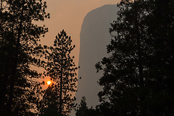 July 19, 2018 - Yosemite National Park, California, U.S - Smoke and haze from the Ferguson Fire nearly obliterates views of the Yosemite National Park iconic feature, El Capitan, as the sun sets on Thursday. (Credit Image: © Tracy Barbutes via ZUMA Wire)