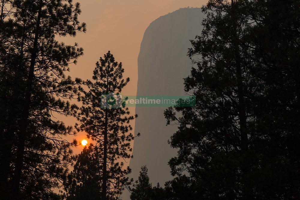 July 19, 2018 - Yosemite National Park, California, U.S - Smoke and haze from the Ferguson Fire nearly obliterates views of the Yosemite National Park iconic feature, El Capitan, as the sun sets on Thursday. (Credit Image: © Tracy Barbutes via ZUMA Wire)