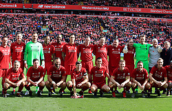 Liverpool Legends line up before the Legends match at Anfield Stadium, Liverpool.