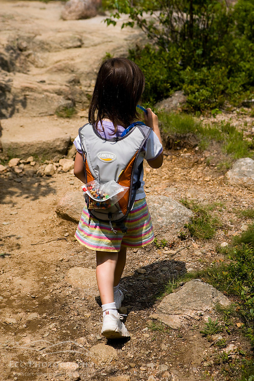 A young girl hiking in Acadia National Park Maine USA