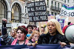 London, UK. 19th January, 2019. Munroe Bergdorf (r) joins thousands of women taking part in the Global Women's March from BBC Broadcasting House to Trafalgar Square to attend a Bread & Roses Rally Against Austerity organised by Women's March London. Inspired by the 1912 Bread & Roses protests which revolutionised workers' rights for women and in the light of Brexit, the organisers called for assurances from the Government in ending policies of austerity which lead to economic oppression, violence against women, the gender pay gap, racism, fascism, institutional sexual harassment and the hostile environment experienced by marginalised groups.