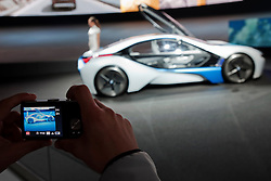 visitor photographing the BMW Vision Efficient Dynamics turbo diesel plug-in hybrid concept Frankfurt Motor Show 2009