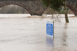 © Licensed to London News Pictures. 20/02/2021. Builth Wells, Powys, Wales, UK. Wind rain and floods in Mid Wales, UK. After a day of continuous rainfall the river Wye bursts it's banks at Builth Wells in Powys, Wales, UK. Photo credit: Graham M. Lawrence/LNP