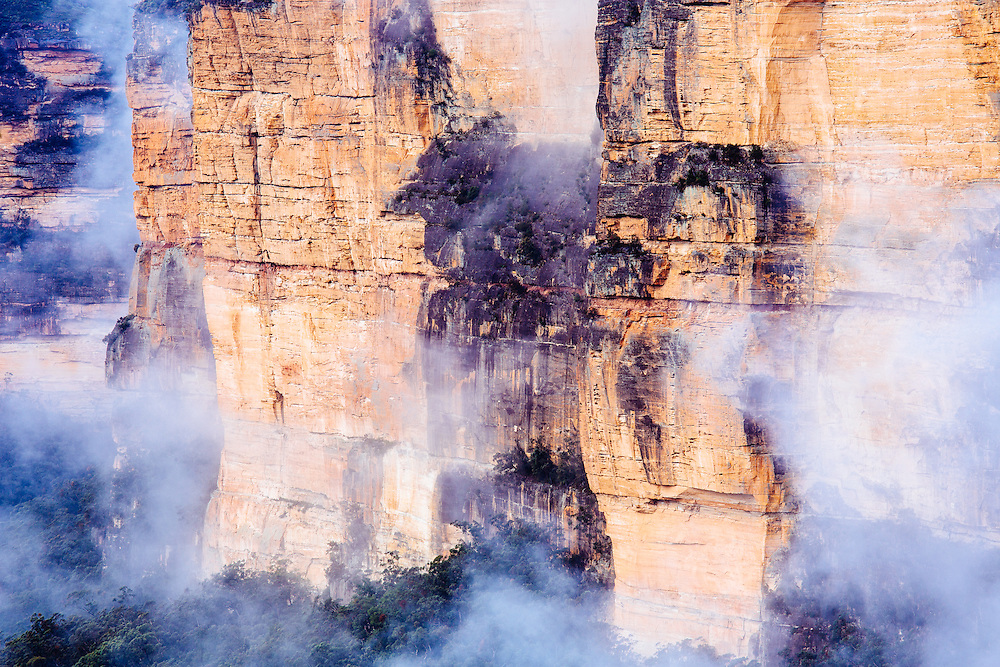 After winter rains, clouds swirl around the sanstone cliffs in the Blue Mountain National Park.